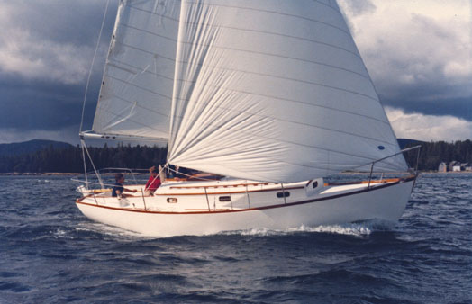 This is one of the early Morris ANNIEs. She was so bloody stiff you could carry the number one genoa even in a twenty knot squall. The redesigned ANNIE 2 is equally beautiful and stable but faster, easier to steer and safer.