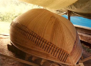 You laminate the cold- molded hull upside down. The deadwood is added once it is finished.