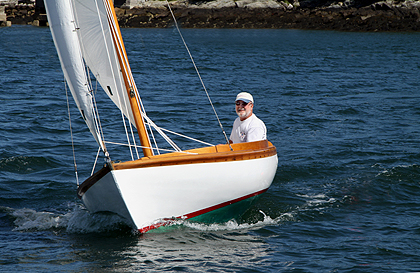 The finest yacht design ever done by anyone. This is Chuck Paine sailing his 75-year-old Herreshoff 12 ½, PETUNIA.