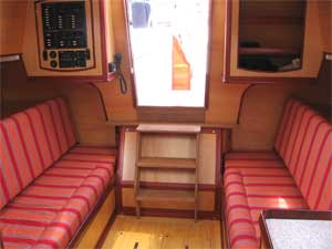 Erica's interior. The seatbacks fold away to reveal wide berths.